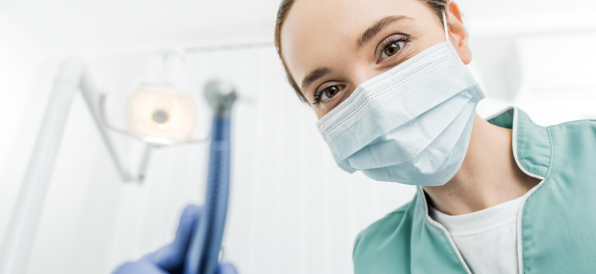 Female Orthodontist Smiling with Medical Mask On